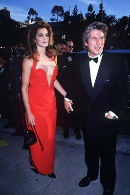Posing on the red carpet in that Versace red dress with then partner Richard Gere