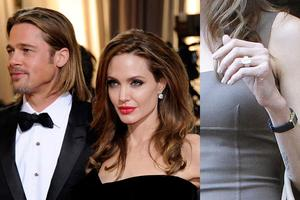 When oh when are Brangelina going to get hitched? Until then, we must console ourselves at gazing at her $500,000 Robert Procop ring that Brad helped design