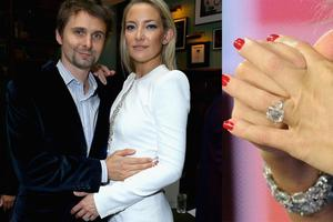 Muse frontman Matt Bellamy proposed to the actress, whom he has been dating since 2010, in NYC. The ring, a platinum-set ring with an emerald-cut diamond and tapered baguettes on the side, is worth around $200,000.