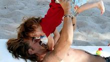 Colin Farrell is the doting dad to two boys