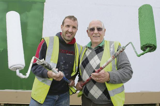 Brendan O'Callaghan with his uncle of the same name painting the IFA's HQ during preparations for the event