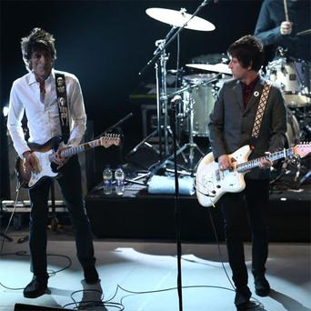 Ronnie Wood and Johnny Marr perform at the NME Awards 2013 at the Troxy on February 27, 2013 in London, England.