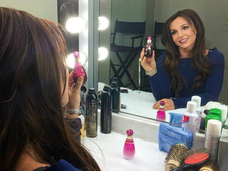 Britney Spears has returned to her original brunette hair to promote her latest perfume