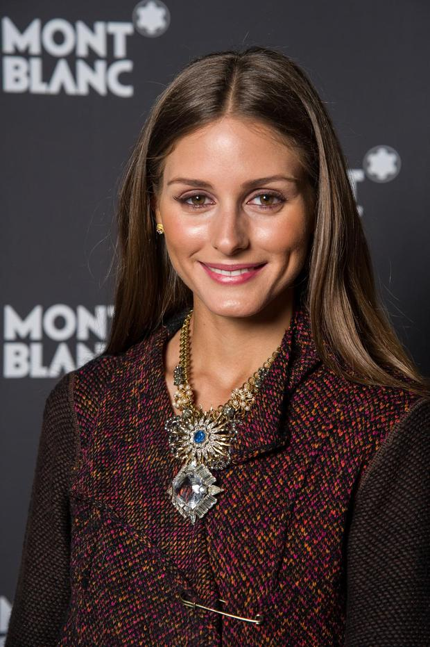 Fashion darling Olivia Palermo jazzes up her tweed coat with an on-trend chunky neckpiece.