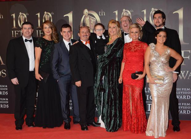 Brendan O'Carroll and the cast of Mrs Brown's Boys pose on the red carpet.