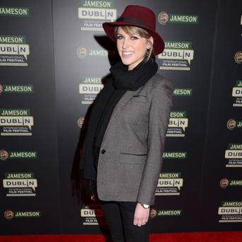 Looking cool in a purple hat and her favourite black scarf at the screening of 'Wilde Salome' in February this year.