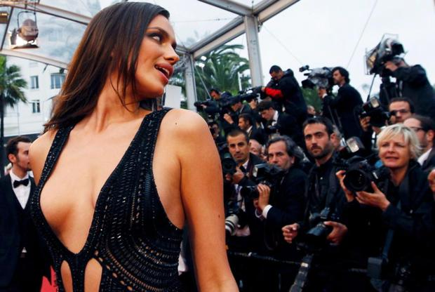 Irina Shayk wore this daring black dress with cut-outs and sheer panels on the red carpet in Cannes.