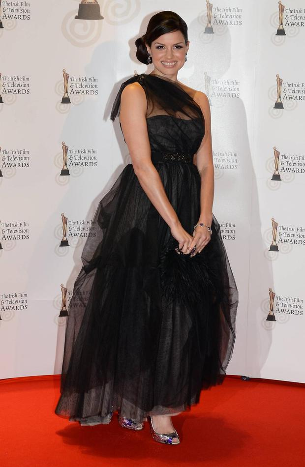 TV presenter turned actress Caroline Morahan brought some Hollywood glamour to the red carpet at the 2011 IFTAs. Her black lace gown ticks all the right fashion boxes.