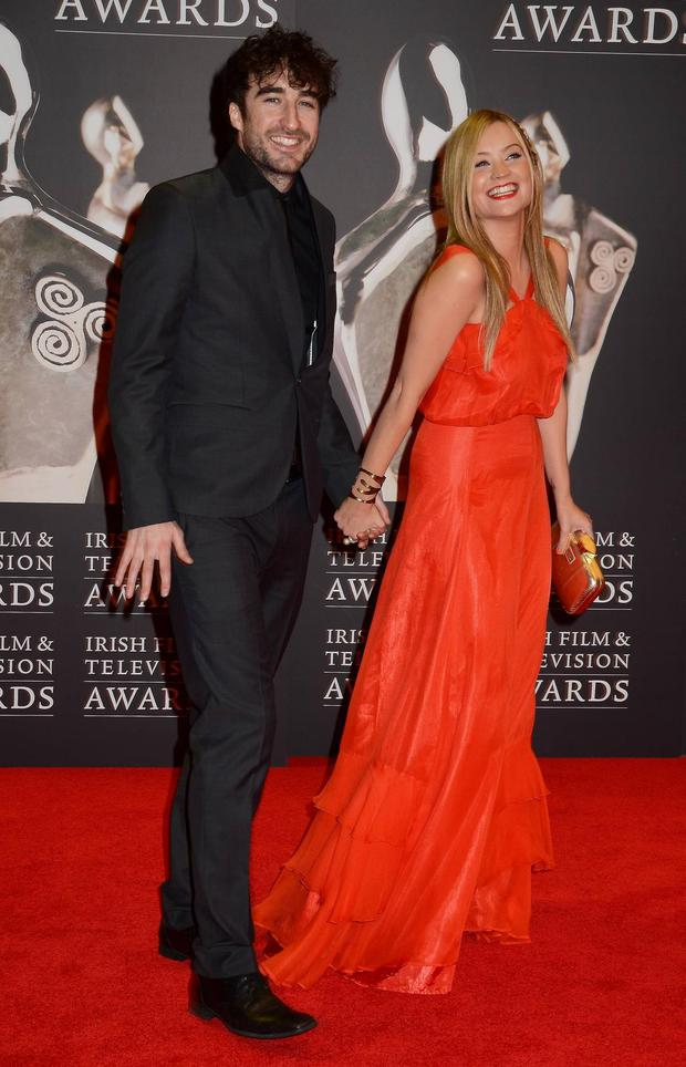 The Coronas frontman Danny O'Reilly lets his former girlfriend, MTV star Laura Whitmore's dress do the talking. She wears a fun red dress by cult designer Belle & Bunty.