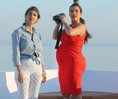 Kim and bump are the ladies (she is having a girl!) in red on holidays with the Kardashian clan in Mykonos, Greece.