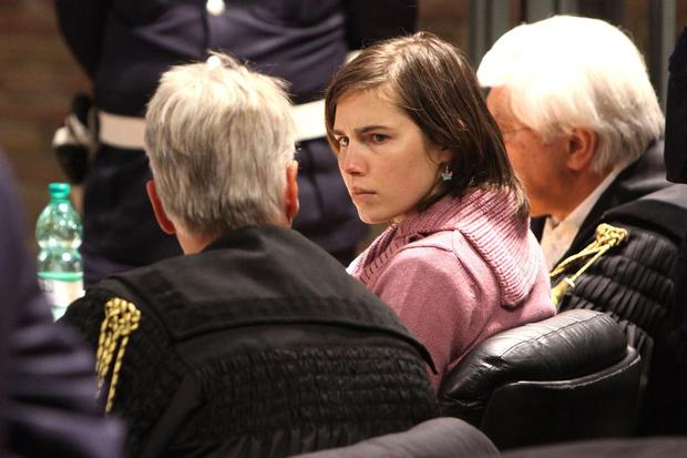 DECEMBER 2010: Amanda Knox, flanked by her lawyers, attends a session of her appeal against her murder conviction in Perugia's court of Appeal on December 18, 2010 in Perugia, Italy.