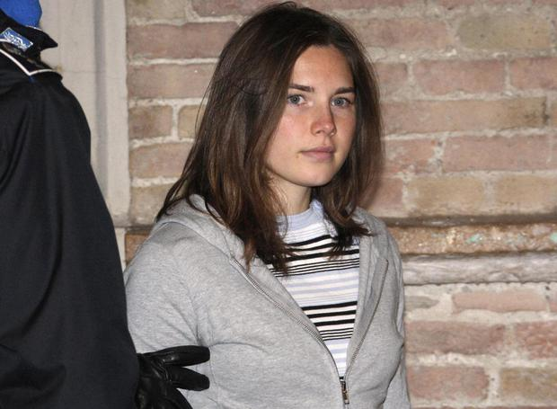 JANUARY 2009: US student Amanda Knox arrives at court in Perugia, charged with the alleged sex-murder of her British housemate in the Italian university town of Perugia on January 16, 2009.