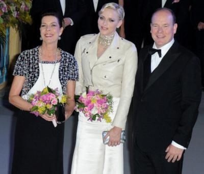 MONTE-CARLO, MONACO - MARCH 23: Princess Caroline of Hanover, Princess Charlene of Monaco and Prince Albert II of Monaco attend the 'Bal De La Rose Du Rocher' in aid of the Fondation Princess Grace on the 150th Anniversary of the SBM at Sporting Monte-Carlo on March 23, 2013 in Monte-Carlo, Monaco. (Photo by Pascal Le Segretain/Getty Images)