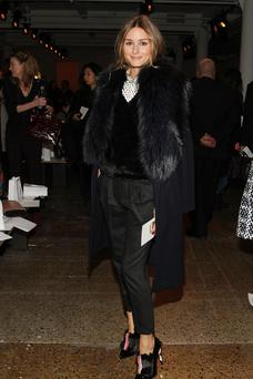 Olivia Palermo attends Peter Som at NYFW in a faux fur ensemble