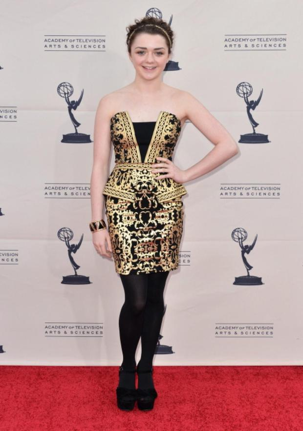 Actress Maisie Williams would have scored better if she left her black opaque tights off. MISS