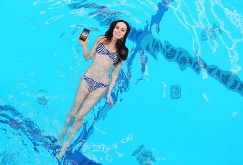 Daniella Moyles going for a quick dip in the pool. With her new phone...