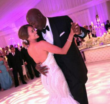 Michael Jordan enjoys his first dance with bride Yvette Prieto at the Bear's Club in Jupiter, Florida.