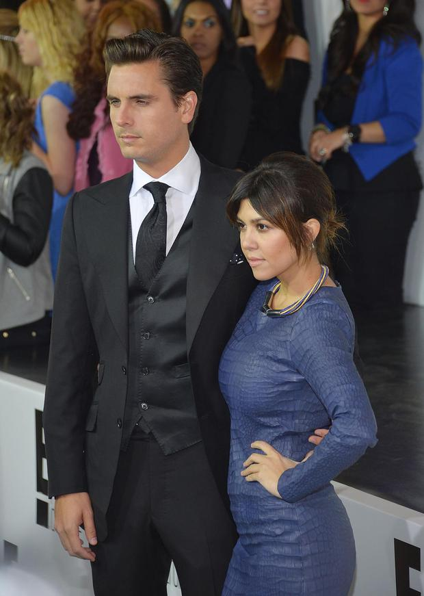 Television personalities Scott Disick (L) and Kourtney Kardashian attend the E! 2013 Upfront at The Grand Ballroom at Manhattan Center on April 22, 2013 in New York City.