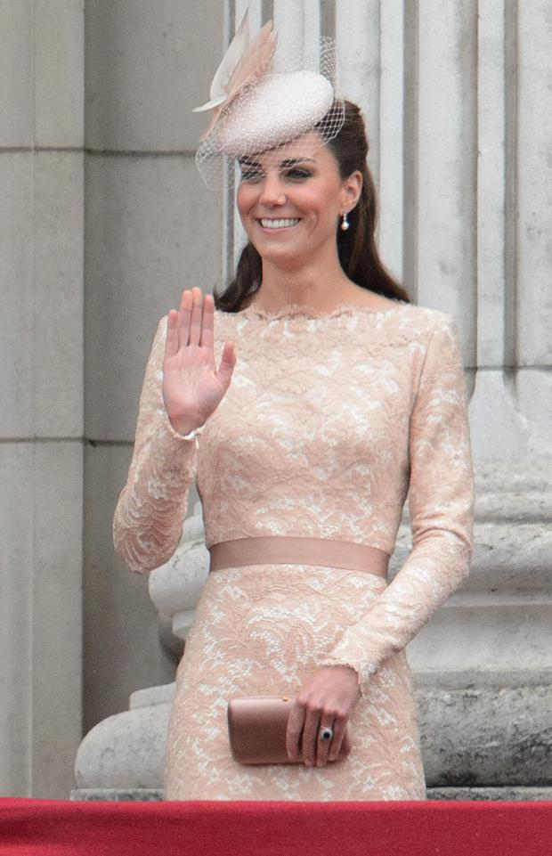Here she is on the balcony of Buckingham Palace as part of the Queen's Diamond Jubilee celebrations in an Alexander McQueen lace dress and a Jane Taylor hat.