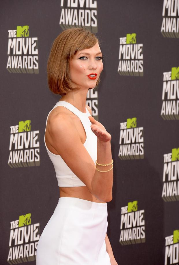 CULVER CITY, CA - APRIL 14: Model Karlie Kloss arrives at the 2013 MTV Movie Awards at Sony Pictures Studios on April 14, 2013 in Culver City, California.