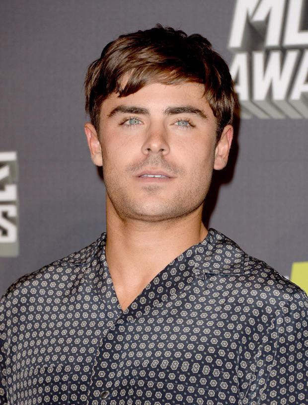 CULVER CITY, CA - APRIL 14: Actor Zac Efron poses in the press room during the 2013 MTV Movie Awards at Sony Pictures Studios on April 14, 2013 in Culver City, California.