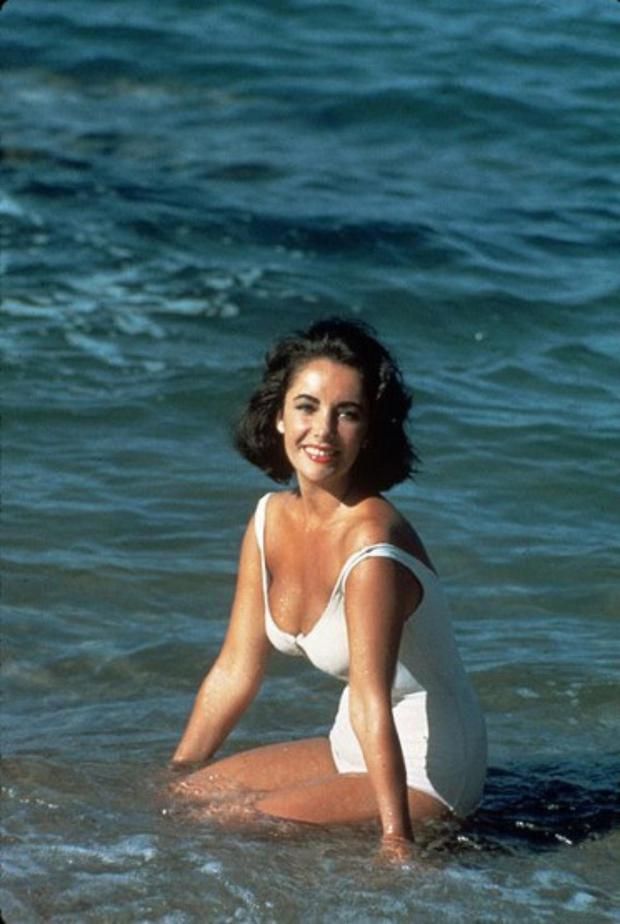 Elizabeth Taylor poses in the surf on the set of 'Suddenly Last Summer' in 1959.