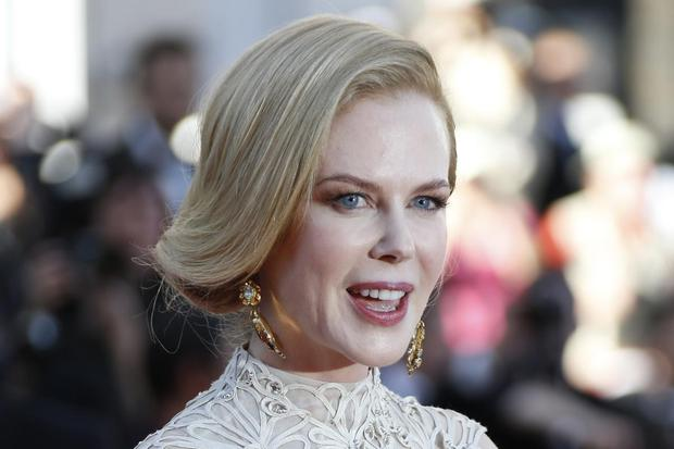 Australian actress and member of the Feature Film Jury Nicole Kidman poses on May 23, 2013 as she arrives for the screening of the film 'Nebraska' presented in Competition at the 66th edition of the Cannes Film Festival in Cannes. Cannes, one of the world's top film festivals, opened on May 15 and will climax on May 26 with awards selected by a jury headed this year by Hollywood legend Steven Spielberg.