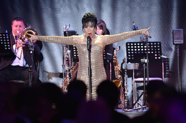 British singer Shirley Bassey performs on May 23, 2013 during the amfAR's 20th Annual Cinema Against AIDS during the 66th Annual Cannes Film Festival at Hotel du Cap-Eden-Roc in Cap d'Antibes, southern France.