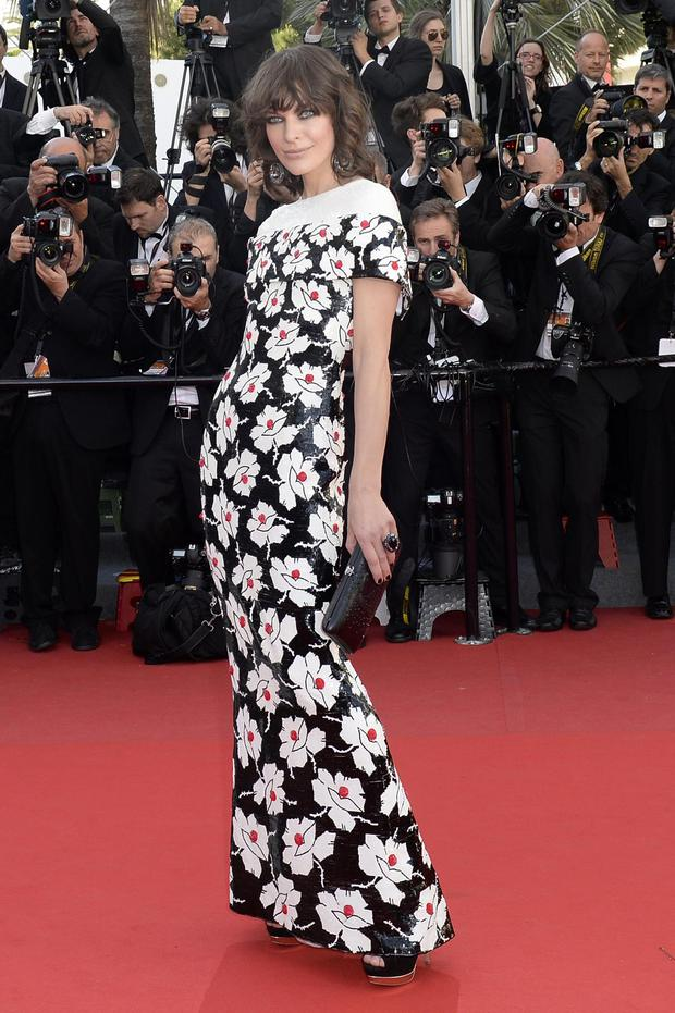 Ukrainian-born actress Milla Jovovich poses on May 20, 2013 as she arrives for the screening of the film 'Blood Ties' presented Out of Competition at the 66th edition of the Cannes Film Festival in Cannes. Cannes, one of the world's top film festivals, opened on May 15 and will climax on May 26 with awards selected by a jury headed this year by Hollywood legend Steven Spielberg.