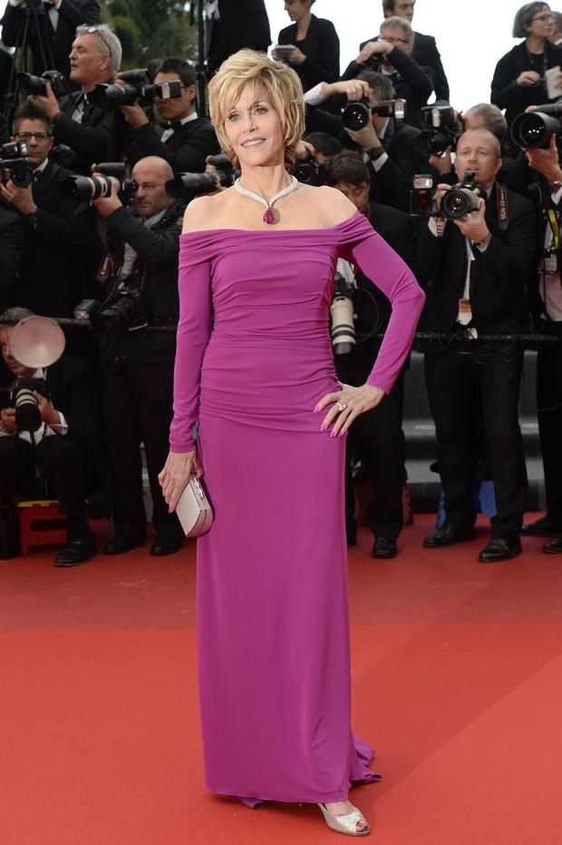 US actress Jane Fonda poses on May 19, 2013 as she arrives for the screening of the film 'Inside Llewyn Davis' presented in Competition at the 66th edition of the Cannes Film Festival in Cannes. Cannes, one of the world's top film festivals, opened on May 15 and will climax on May 26 with awards selected by a jury headed this year by Hollywood legend Steven Spielberg.