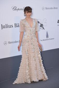 Ukrainian-born actress Milla Jovovich poses on May 23, 2013 as she arrives for the amfAR's 20th Annual Cinema Against AIDS during the 66th Annual Cannes Film Festival at Hotel du Cap-Eden-Roc in Cap d'Antibes, southern France.