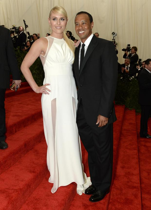"""World Cup skier Lindsey Vonn (L) and golfer Tiger Woods (R) arrive at the Metropolitan Museum of Art's Costume Institute Gala benefit in honor of the museum's latest exhibit, """"Punk: Chaos to Couture """" May 6, 2013 in New York."""
