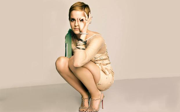Emma Watson, rocking a pixie cut, poses in a pair of strappy heels for a cover shoot with Marie Claire.