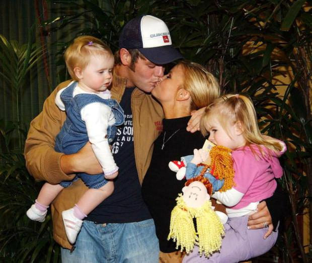 Before their split, Brian played dutiful husband and welcomed his wife as she left the jungle having been crowned the winner of 'I'm A Celebrity: Get Me Out Of Here' in 2004. Daughters Molly and Lily also accompanied him.