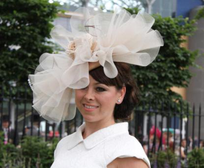 Lisa Scott-Lee wore a quirky champagne headpiece