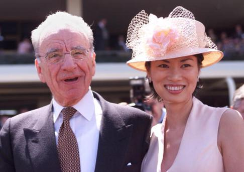 In one of their first outings as newlyweds, Rupert and Wendi dress to impress at the Melbourne Cup in November 1999.