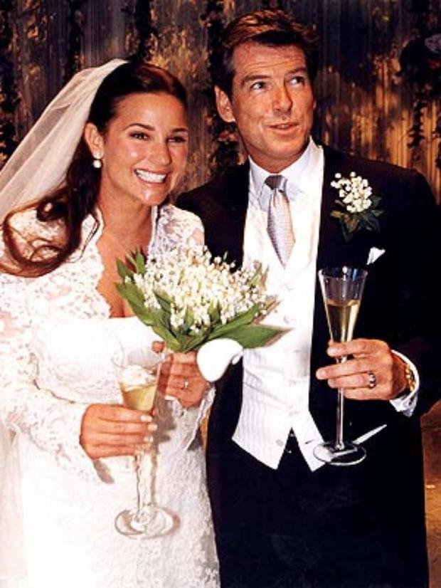Husband Pierce Brosnan with wife Keely Shaye Smith on their wedding day