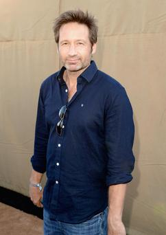 LOS ANGELES, CA - JULY 29: Actor David Duchovny arrives at the CW, CBS and Showtime 2013 summer TCA party on July 29, 2013 in Los Angeles, California.