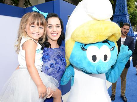 Actress/singer Katy Perry (R) attends the Los Angeles premiere of 'The Smurfs 2' at Regency Village Theatre on July 28, 2013 in Westwood, California.