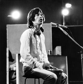 Mick Jagger, vocalist with British rock group The Rolling Stones, in a recording studio during the filming of 'Sympathy For the Devil', directed by French film director Jean-Luc Godard. (Photo by Keystone Features/Getty Images)