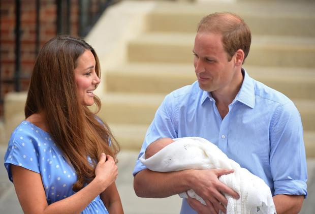 Prince William and Catherine, Duchess of Cambridge show their new-born baby boy to the world's media outside the Lindo Wing of St Mary's Hospital in London on July 23, 2013