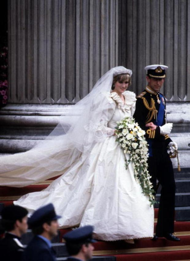 Diana, Princess of Wales, wearing an Emanuel wedding dress, leaves St. Paul's Cathedral with Prince Charles, Prince of Wales following their wedding on 29 July, 1981 in London, England. (Photo by Anwar Hussein/Getty Images)