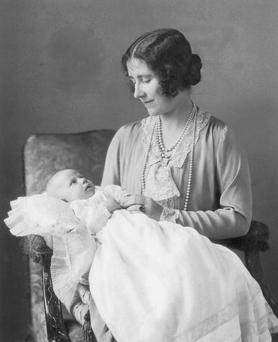 The Queen Mother holds her second daughter, Princess Margaret for an official portrait in 1930.
