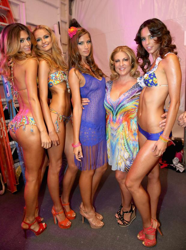MIAMI, FL - JULY 21: Designer Lourdes Hanimian (2nd from R) poses with models backstage at the Luli Fama show during Mercedes-Benz Fashion Week Swim 2014 at Cabana Grande at the Raleigh on July 21, 2013 in Miami, Florida.