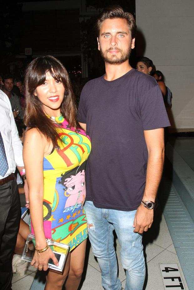 MIAMI BEACH, FL - JULY 21: (L-R) TV personalities Kourtney Kardashian and Scott Disick attend the Wildfox Swim Cruise 2014 show at Soho Beach House on July 21, 2013 in Miami Beach, Florida.