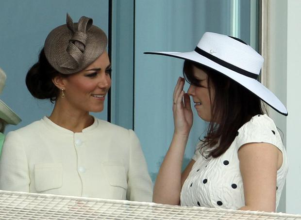 Members of Britain's royal family, Kate, Duchess of Cambridge (L) speaks with Princess Eugenie (R) on the balcony ahead of The Derby horse race during the second day of the Epsom Derby Festival, in Surrey, southern England, on June 4, 2011. Pour Moi ridden by Jockey Mickael Barzalona won the race, Treasure Beach came second and race favorite Carlton House came third place. The Queen's horse, Carlton House, ridden by Ryan Moore, was seeking to be the first Derby winner owned by a reigning monarch since Minoru won in 1909 for King Edward VII.