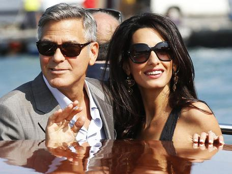 Finally - the woman whos getting him up the aisle. George will wed human rights lawyer Amal Alamuddin in Venice today.