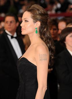Style it like Angelina Jolie- an all-black ensemble can be teamed with colour pop accessories.