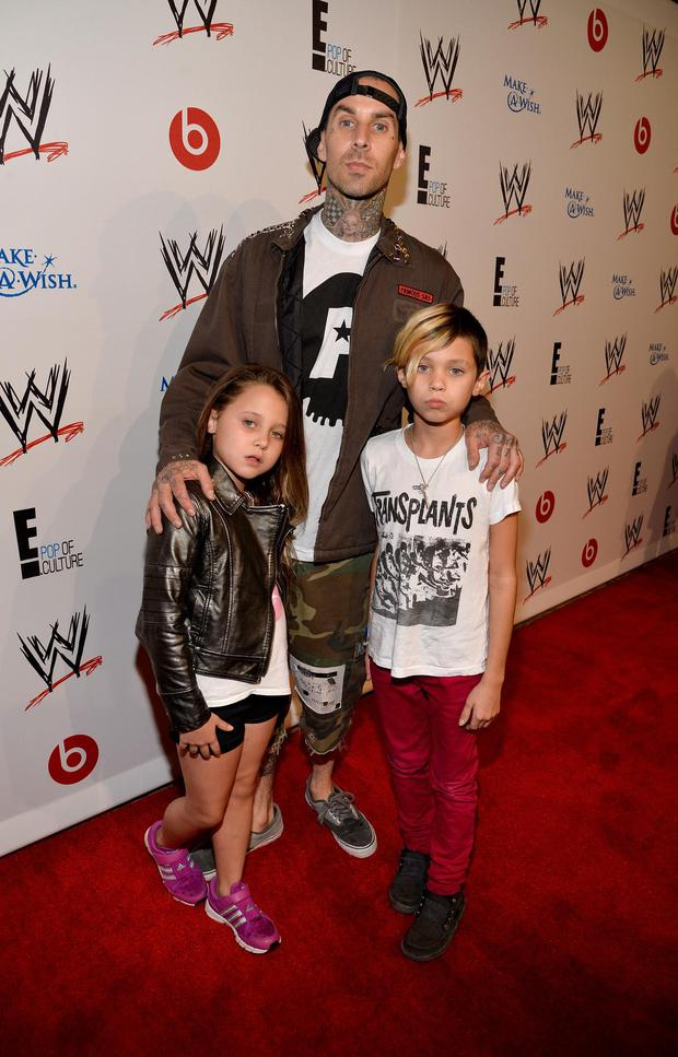 Alabama Barker, musician Travis Barker, and Landon Barker attend WWE & E! Entertainment's 'SuperStars For Hope' at the Beverly Hills Hotel on August 15, 2013 in Beverly Hills, California.