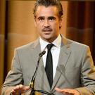 BEVERLY HILLS, CA - AUGUST 13: Actor Colin Farrell speaks onstage at the Hollywood Foreign Press Association's 2013 Installation Luncheon at The Beverly Hilton Hotel on August 13, 2013 in Beverly Hills, California.